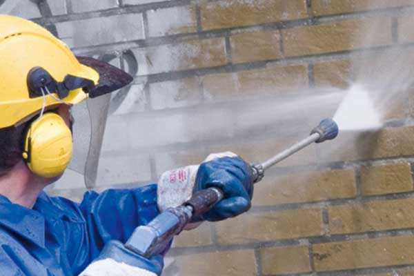 industrial cleaning through graffiti removal