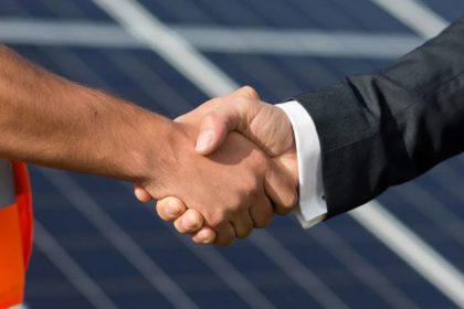 handshake to show drainage contract has been renewed